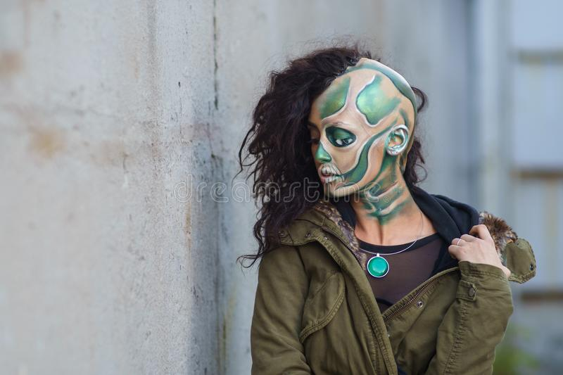 Yang woman with Makeup of green skull for halloween. Portrait of a terrible skull royalty free stock photography