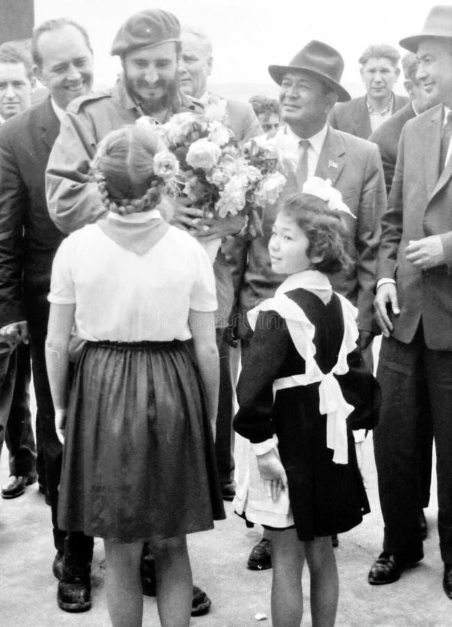 Yangiyer pioneer girls meet Fidel Castro 1963. Old black and white photo: Pioneer girls meet Fidel Castro in the May 1963 in Yangiyer, Uzbekistan stock image