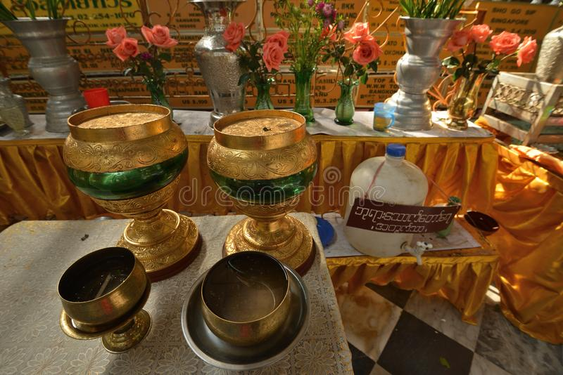 Yangon Bago buddha temple handcrafe container. Myanmar Burma Yangon Bago temple handcraft decoration flower stock photos