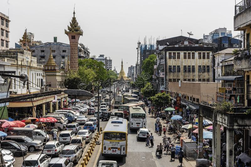 Busy downtown street view in Yangon and Sule Pagoda at the heart of Yangon city, Myanmar royalty free stock photo