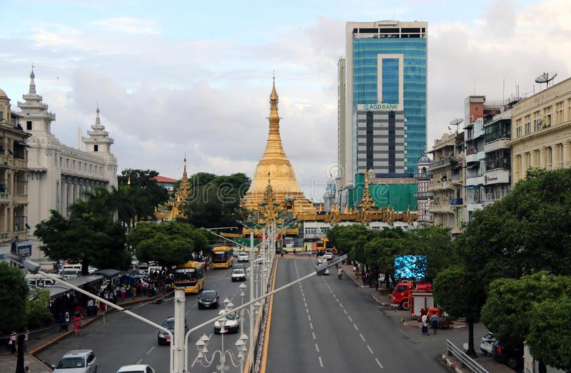 Golden octagon of Sula pagoda located in the heart of downtown Yangon, making it more than 2,600 years old. Yangon, Myanmar June 6, 2018: Golden octagon of Sula stock image