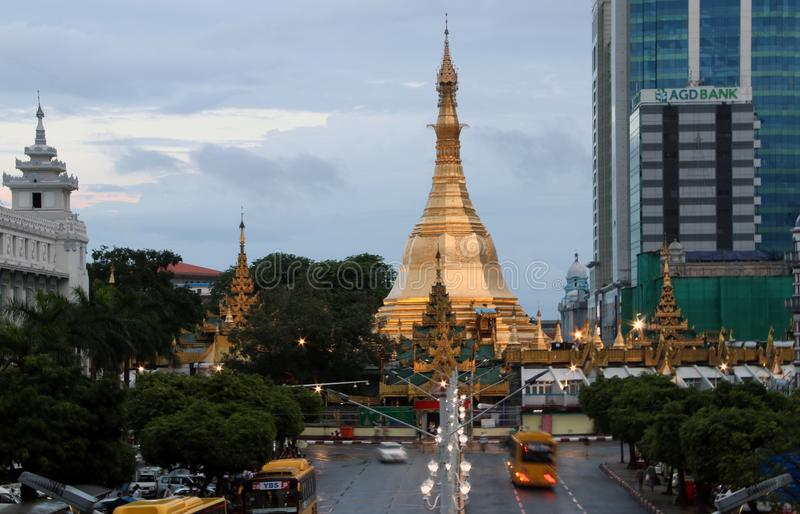 Golden octagon of Sula pagoda located in the heart of downtown Yangon, making it more than 2,600 years old. Yangon, Myanmar June 6, 2018: Golden octagon of Sula royalty free stock image