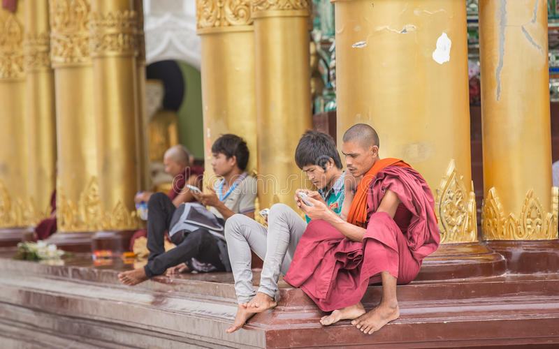 Yangon, Myanmar - JUNE 22, 2015 monks unidentified seating calling on the Burmese and foreigners at Shwedagon Pagoda on Yangon, M royalty free stock images