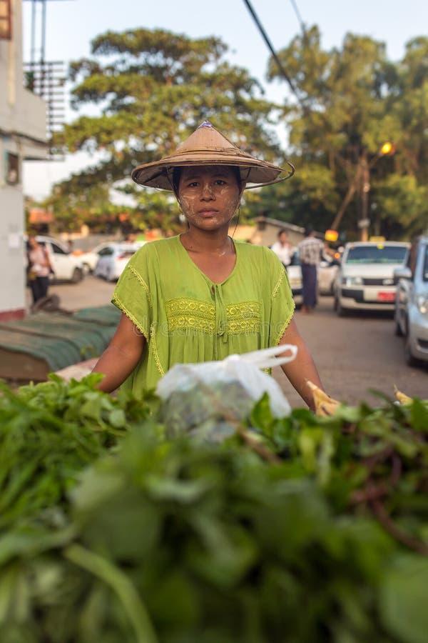 Unidentified burmese woman selling vegetables from street stall in Yangon, Myanmar. royalty free stock photos