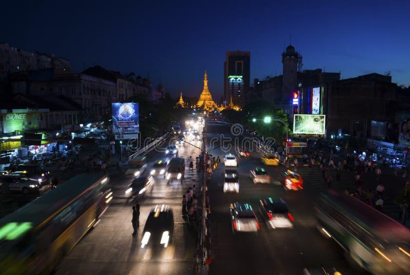 Yangoon at night. Street life in Yangoon at night, golden stupa central, Myanmar royalty free stock images