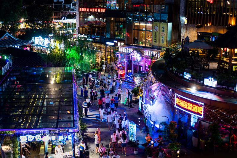 Yangshuo, China - July 27, 2018: Crowded night at popular travel city of Yangshuo near Guilin in China royalty free stock photography
