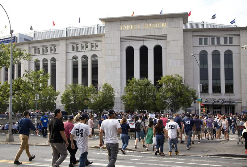 Yankee fans head to the stadium to enjoy the game. BRONX, NEW YORK/USA - June 17, 2019: Yankee fans head to the stadium to enjoy the game stock images