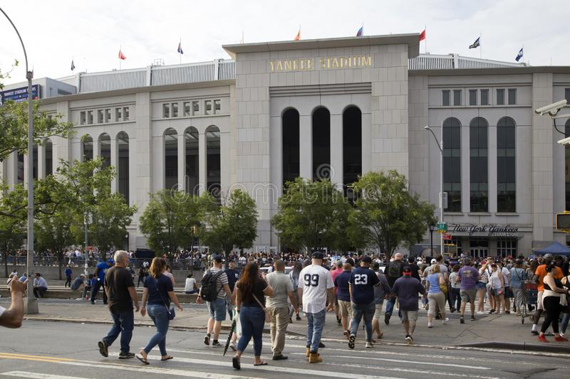 Yankee fans head to the stadium to enjoy the game. BRONX, NEW YORK/USA - June 17, 2019: Yankee fans head to the stadium to enjoy the game royalty free stock images