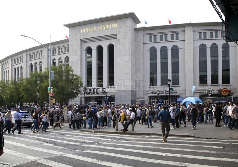 Yankee fans head to the stadium to enjoy the game. BRONX, NEW YORK/USA - June 17, 2019: Yankee fans head to the stadium to enjoy the game stock image