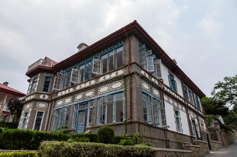 Yantai, China - one of the many german style buildings in Yantai. Shan, a hill in the old town with also a temple, a lighthouse and the famous smoke terrace that royalty free stock photos