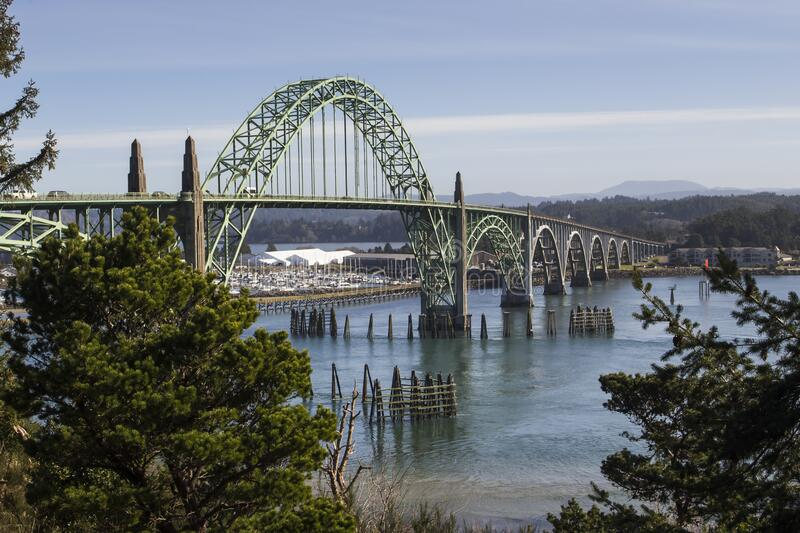 Yaquina Bay Bridge in sunny day. Yaquina Bay bridge in Oregon. Opened in 1936 on route 101 coast highway this stylized arch bridge passes over Yaquina Bay in royalty free stock images