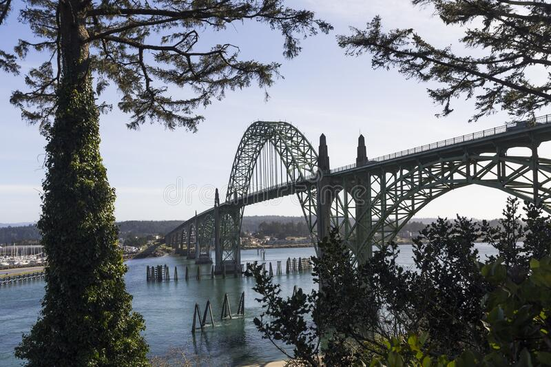 Yaquina Bay Bridge in sunny day. Yaquina Bay bridge in Oregon. Opened in 1936 on route 101 coast highway this stylized arch bridge passes over Yaquina Bay in royalty free stock photos