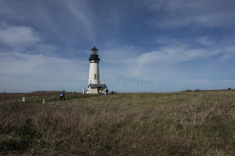 Yaquina Head Lighthouse, Newport, Oregon. This 93 foot lighthouse tower was constructed in 1873. It operated with an oil lamp and a Fresnel lens to keep ships royalty free stock image