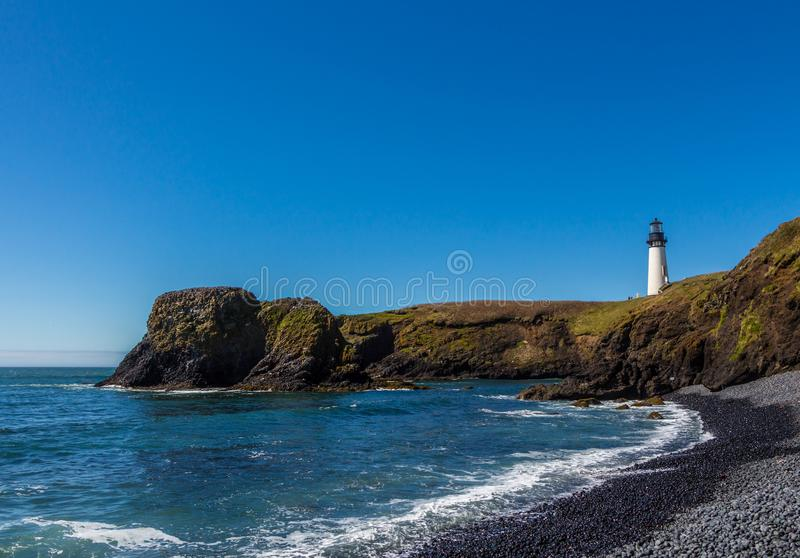 Yaquina Head Lighthouse view from beach royalty free stock photo