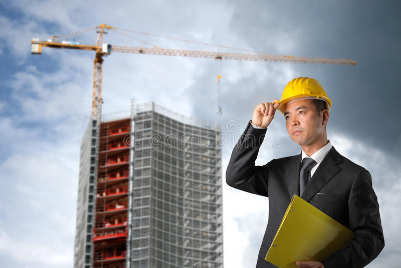 Yard. Business man with hard hat in a erection yard royalty free stock photos