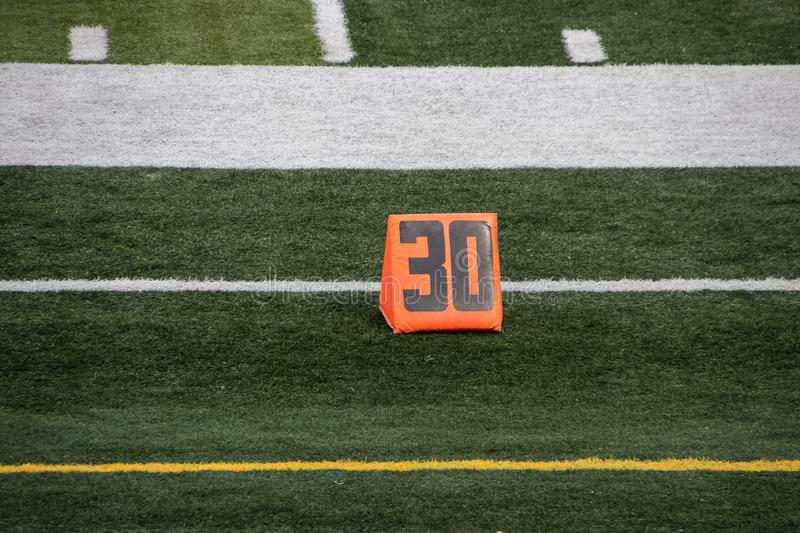 30 yard line marker at American football game stock image