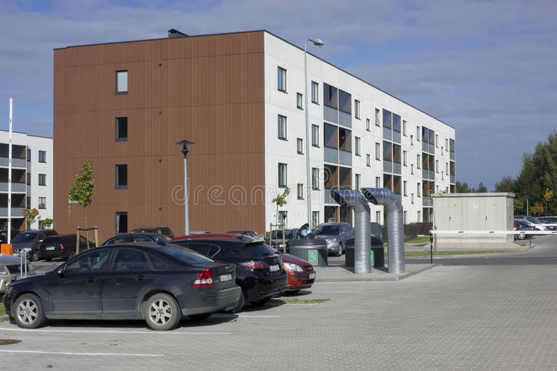 Yard of a modern town house. VILNIUS, LITHUANIA - SEPTEMBER 25, 2016: In the yard of a modern town house there is a parking, pipes of underground ventilation and stock photography