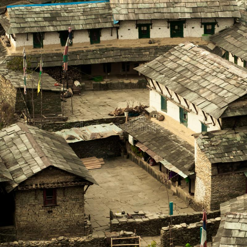 Yard in the Nepalese village. Traditional Nepalese house, trekking to the Annapurna royalty free stock image