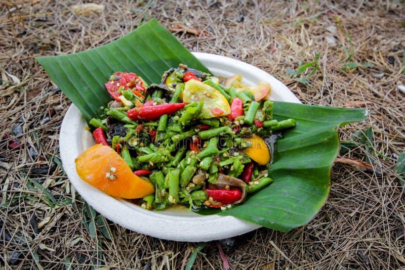 Yardlong bean spicy salad. On banana leaf royalty free stock photography