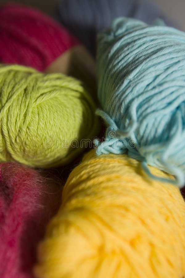 Yarn. Different colors of yarn bundles. The focus is selective stock photography