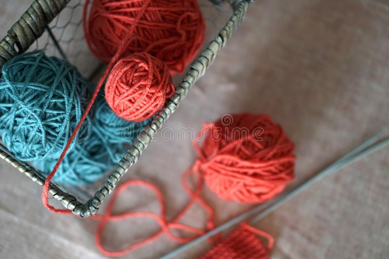 Yarn balls and basket. Color thread for knitting. Colors concept stock image