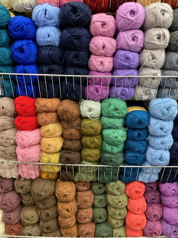 Multicolored, wool ball yarn in a store. ready for needlework. Yarn beautiful color ready to knit or crochet stock photos