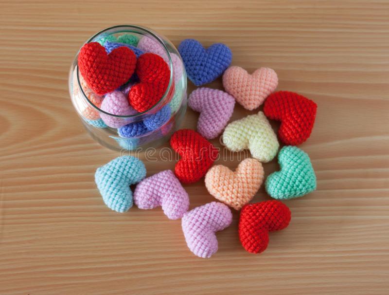 Yarn Heart in a glass jar on wooden background. Colorful yarn Heart in a glass jar on wooden background royalty free stock photo