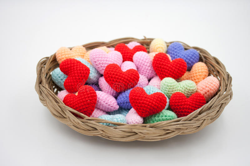 Yarn hearts in the basket. royalty free stock photo