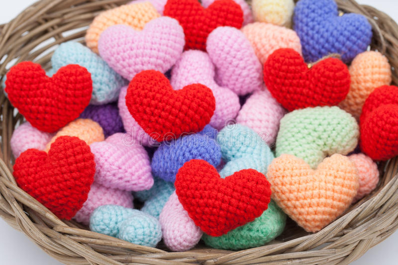 Yarn hearts in the basket. stock image