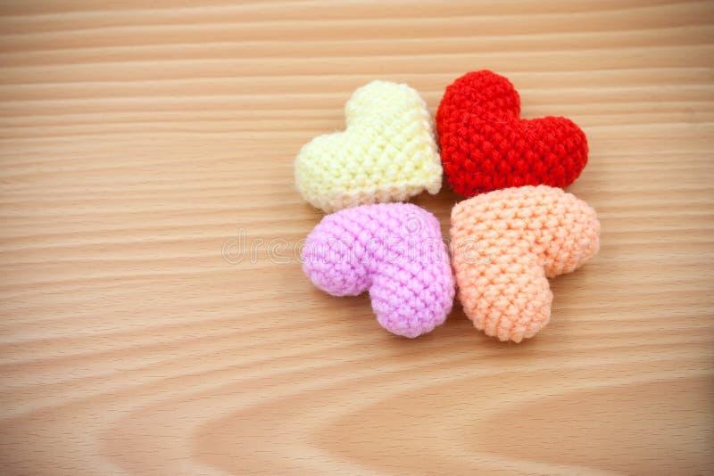 Yarn hearts on wood background royalty free stock photos