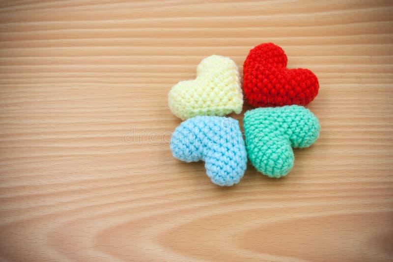 Yarn hearts on wood background stock image