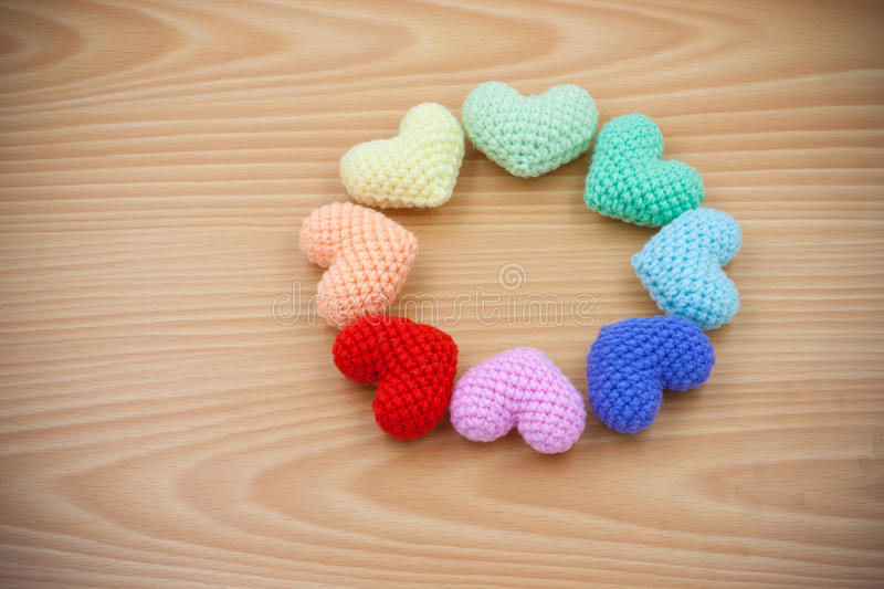 Yarn hearts on wood background stock images