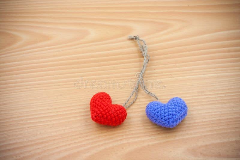 Yarn hearts on wood background royalty free stock image