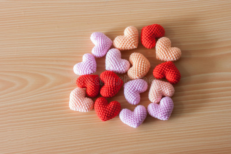 Yarn hearts on wood background royalty free stock images