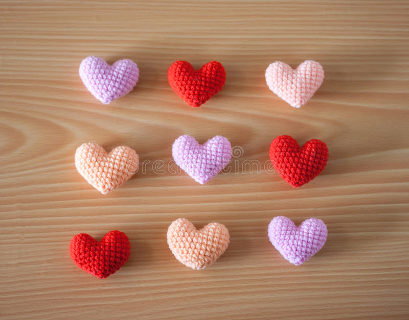 Yarn hearts on wood background royalty free stock photography