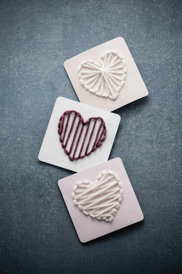 Yarn Hearts. Yarn wrapped hearts, homemade decorations stock image