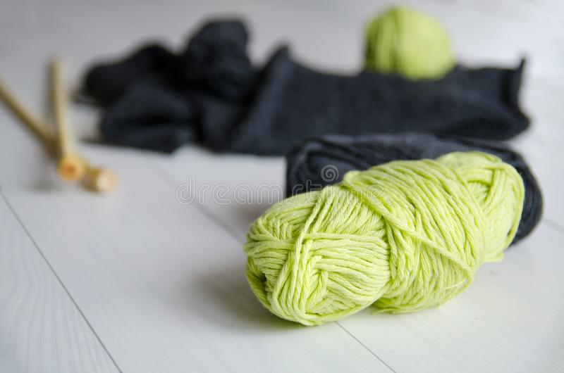 Yarn for knitting close-up on white wooden background. The concept of Hobbies, crafts, the beginning of a new knitting project stock photo