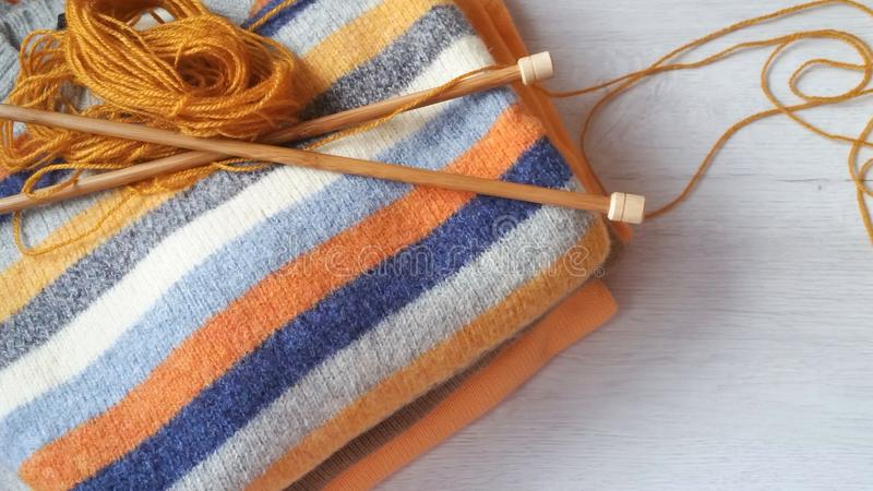 Yarn for knitting and handmade sweaters. In grey, orange, ocher and terracotta colors royalty free stock photos