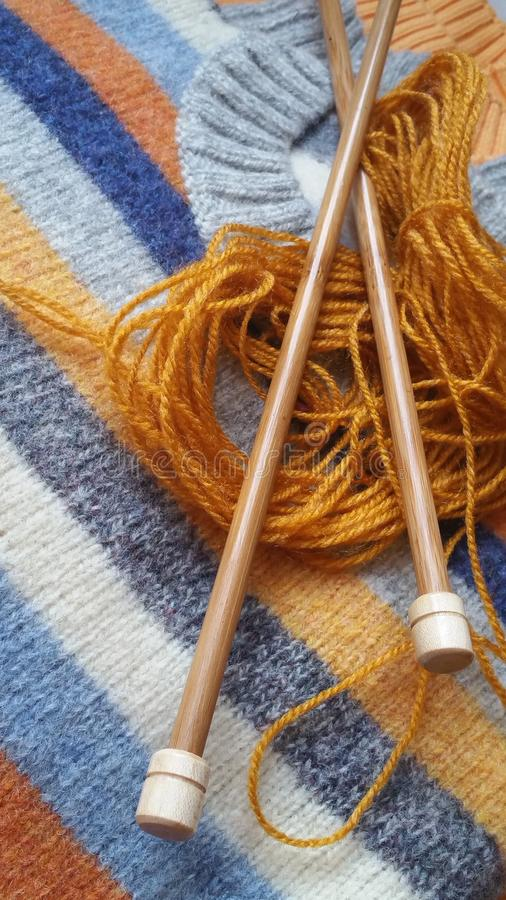Yarn for knitting and handmade sweaters. In grey, orange, ocher and terracotta colors royalty free stock photography