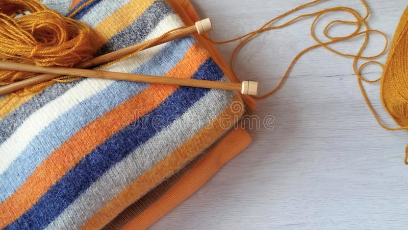 Yarn for knitting and handmade sweaters. In grey, orange, ocher and terracotta colors royalty free stock images