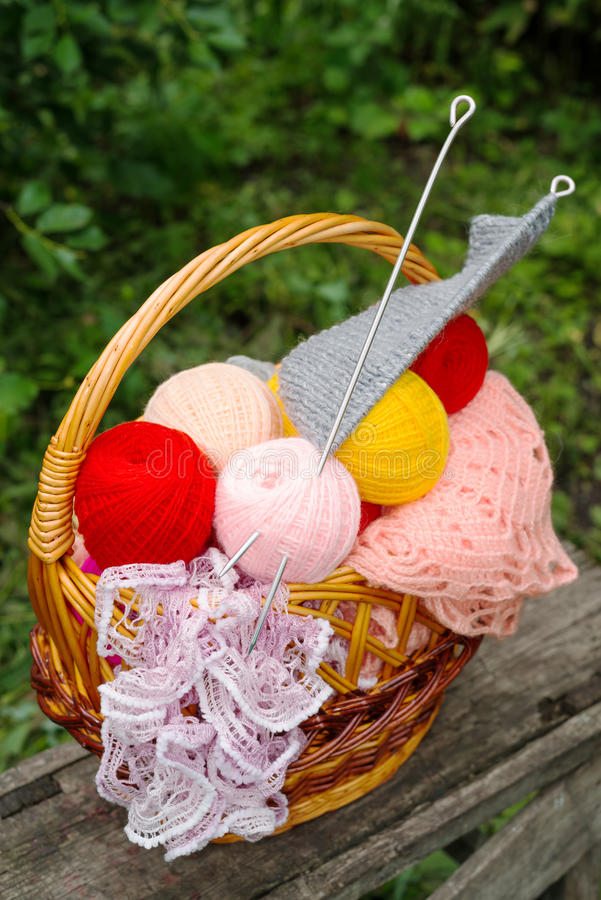 Yarn and knitting needles. Basket of yarn and knitting needles royalty free stock image