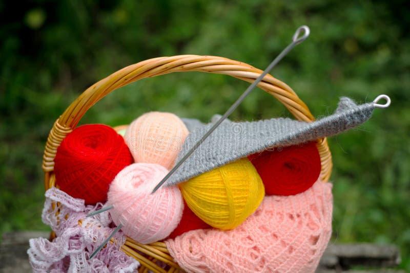 Yarn and knitting needles. Basket of yarn and knitting needles stock photo