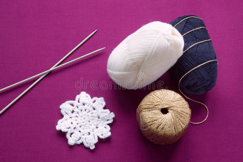 Yarn and knitting needles stock images