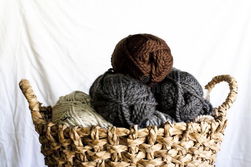 Yarn Skeins in a Wicker Basket stock images