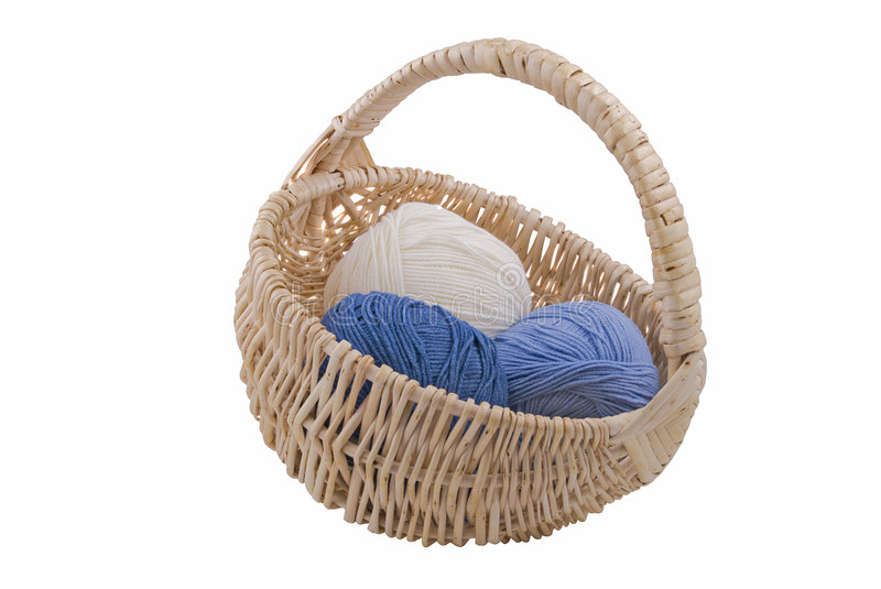 Yarn in wicker basket royalty free stock images