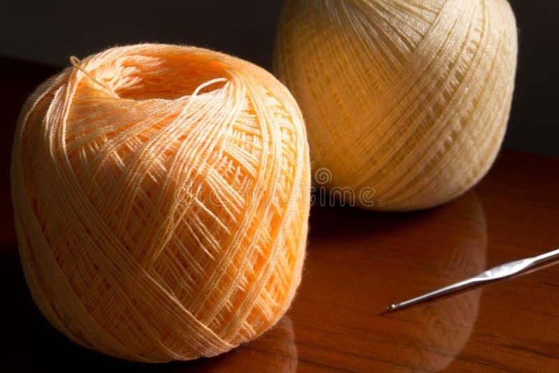 Yarn on wood background. Orange yarn on wood background royalty free stock images