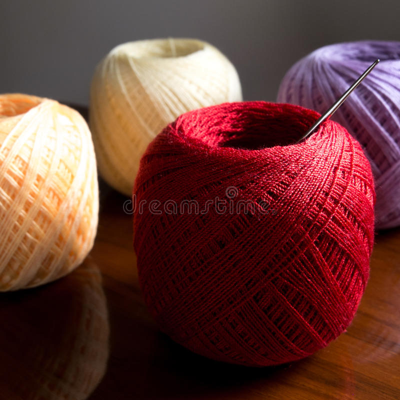 Yarn on wood background. Red yarn on wood background stock image