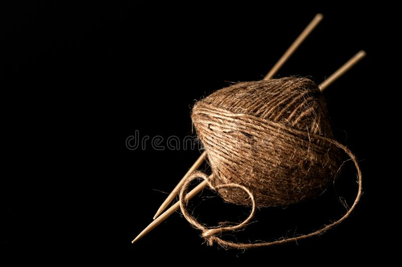 Yarn and wooden knitting needles royalty free stock image