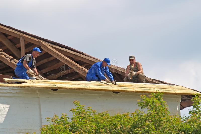 YAROSLAVL, RUSSIA. Carpenters repair a building roof royalty free stock image
