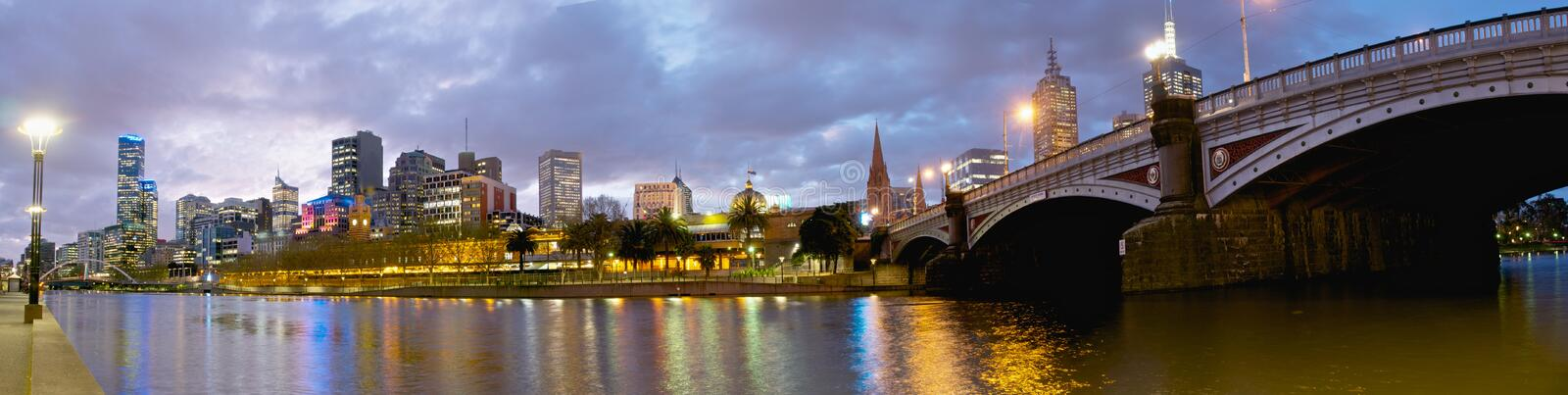 Yarra river at dusk. Panorama of Melbourne lwith city lights reflected in yarra river at dusk royalty free stock photography